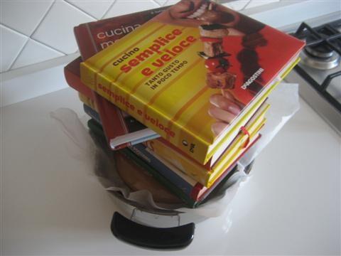 coprire con carta da forno e mettere un peso